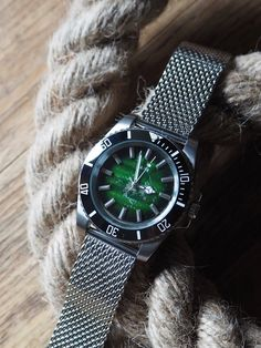 I take vintage dials with perfect patina and build unique new watches around them. This one is a quartz model with steel case, ceramic bezel and milanese/shark mesh bracelet/strap. It's a little like the reverse of a Rolex Kermit Submariner, but this one is 100% unique. Click picture for more info. Watches Photography, Mesh Bracelet, Kermit, Vintage Watches, Emerald Green, Shark, Rolex, Toms, Quartz