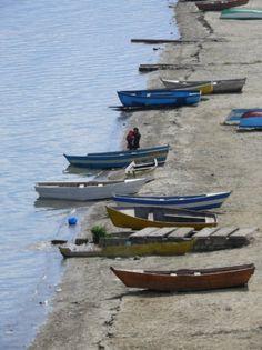 Miss walks on this beach...Fishing boats. Pogradec, Albania
