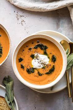Cold nights are made better with this Golden Sweet Potato Soup. Each bowl is swirled with fried sage pesto and topped with creamy burrata cheese to create the perfect savory bowl of soup that's warming and so delicious. A mix of healthy and indulgent, serve as an easy dinner or as part of this year's Thanksgiving menu!