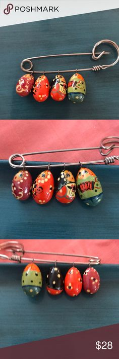 Handpainted Russian Nesting Doll Pin Incredible pin with meticulously hand painted Russian nesting doll charms. Lovingly and amazingly detailed. Each tiny doll is different! Please see photos for size. Jewelry Brooches