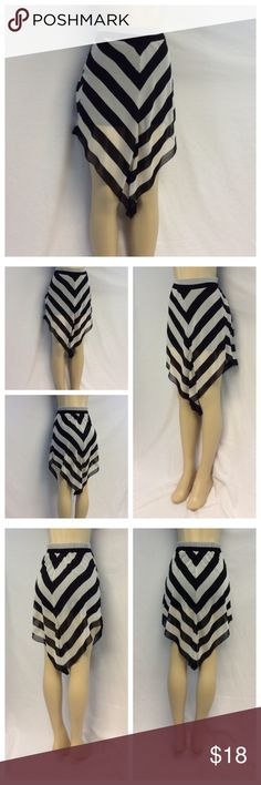 "CHARLOTTE RUSSE V STRIPE SKIRT CHARLOTTE RUSSE V STRIPE SKIRT, black n cream Hilo, Size S, machine was, 100% polyester shell & lining. Approximate measurements are 13"" waist laying flat, 17 waist to hem at shortest point, 29"" at longest point, black lining is 17"" long. 0232 Charlotte Russe Skirts High Low"