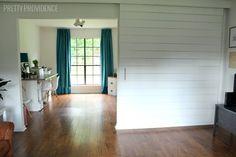 DIY Sliding Barn Door - modern way to add a door to your house!