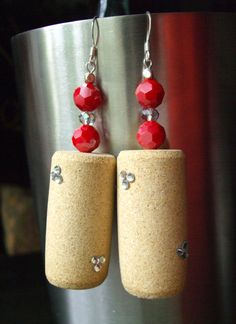 Twinkle :: Handmade wood wine cork dangle earrings featuring clear Swarovski Elements rhinestones, ruby glass faceted opaque beads, glass sapphire beads and silver spacer beads.  www.grapevarietyjewelry.etsy.com