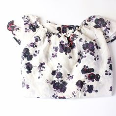 Gap Floral Top Super cute full length (folded in pic) Gap top with keyhole and red button in the back. 70% cotton 30% silk. Great condition, comes with a replacement button! Additional pics and measurements available upon request:) GAP Tops Blouses