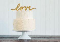 "Glitter ""LOVE"" script wedding cake topper"