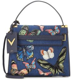 Valentino - My Rockstud embellished denim shoulder bag - We love the fresh, colourful update to Valentino's 'My Rockstud'. The denim upper is made cheerful with an allover butterfly embellishment. We adore this bag worn with your nonchalant chic look at the weekend or with a sleek pencil skirt to the office. seen @ www.mytheresa.com