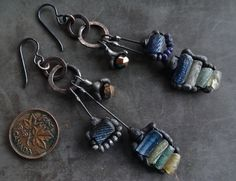 Ancient glass, tiny lapis & faceted bronzed glass. Niobium ear wires.  3.25 inches.