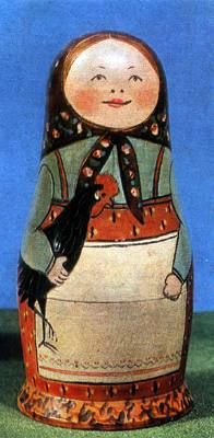 One of the first russian set of nesting dolls - girl with black cock in hands.Toy's museum city Sergiev Posad Moscow area