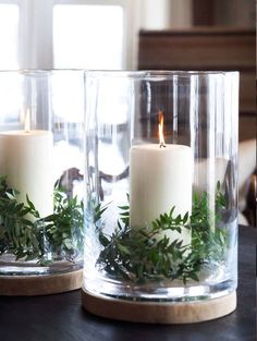 Garden greenery, church candle and glass candle holder make a lovely arrangement.                                                                                                                                                                                 More