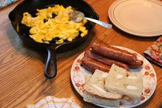 Eggs, Chicken sausages and toasted ciabatta bread.
