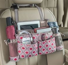 A place (or pocket) for everything, the SwingAway driver organizer holds phones, cords, tablets, bottles, sunglasses, snacks and more, conveniently within easy reach. Swing it to the back for passenger access. See our new Sahara patterned car organizer collection at http://www.highroadorganizers.com