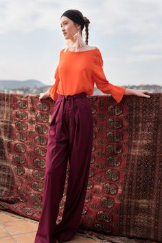 These wide leg pants are made from a soft touch wool blend for a comfortable and elegant wear. The high rise palazzo cut gives a taller allure to the legs, best worn with a tucked in shirt or top. Easy to adjust at waist with the constructed belt that knots for a subtle detail. #viktoriavarga #viktoriavargabudapest #designer #hungariandesigner #handmade #ootd #outfit #burgundy #trousers #wool Palazzo Trousers, Best Wear, Wide Leg Pants, Wool Blend, Knots, Burgundy, Touch, Belt, Detail