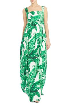 This **Dolce & Gabbana** dress features a vibrant palm leaf print and pleated maxi-length skirt.