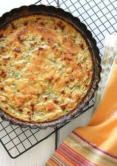 Crustless Summer Zucchini Pie is a simple savory pie made with zucchini, shallots, mozzarella and Parmesan cheese.