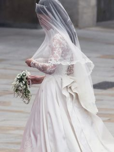 Kate..Love this pic; it is as if she is looking at the veil, and thinking,,,IS this finally happening for us?