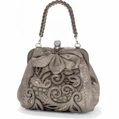 Catch The Moon Pursette  available at Brighton. Love the look and shape of this bag, especially the delicate cutout work and the petals. Hope I win a gift card so I can own this beauty!