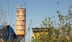 Bearded man painted on water tower by graffiti artist Nikita Nomerz