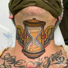Awesome winged hourglass neck and throat tattoo by Meghan Patrick. #12ozstudios #team12oz #tattoo #tattoos #tattooed #tattooing #tattooism #tattooart #tattooartist #tattooer #tattooist #art #artstudio #tattooshop #tattoostudio #ink #inked #colortattoo #colortattoos #necktattoo #necktattoos #throattattoo #throattattoos #hourglass #hourglasstattoo #hourglasstattoos