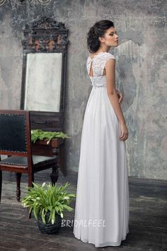 A classic a-line dress in empire style with a decorated lace keyhole back bodice and a falling chiffon skirt.