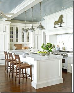 Pretty crisp white kitchen with blue ceiling