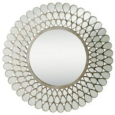 """Bring a chic pop of style to your living room, foyer, or den with this eye-catching Kichler accent, hand-picked by author and interior designer Stephanie Stokes.Product: Wall mirrorConstruction Material: Mirrored glass and MDFColor: Antique silverDimensions: 35"""" Diameter"""