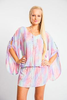 Feel free to twirl and twirl in this fun loving tunic. The sleeves are tied together with three ties on each side. The upper back is exposed to the kiss of the sun. There is an elastic band at the waist. Throw this over your bikini, a pair of shorts, or be daring and wear this for a night out on the town. Embrace all things Hawaii!