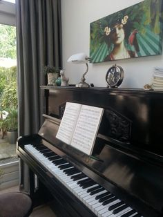 I love the old piano in combination with the classic lamp and clock.