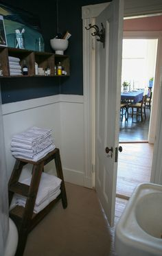 White door trim and hooks. Good mix of antique elements and storage needs