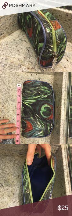 Sisley makeup bag Sisley peacocks design makeup bag.  Excellent condition, like new. Sisley Makeup Brushes & Tools