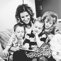 cuddling with a book, blankies and kids