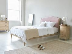 Coco upholstered French wooden bed
