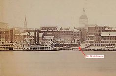 St. Louis riverfront, 1862. The Old Cathedral's spire is on the left. The Old Courthouse dome looms overhead. The Old Rock House is down on the levee.