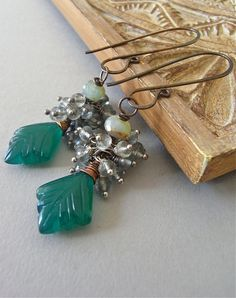 The Peppermint earrings - gorgeous carved onyx leaves are topped with a cluster of moss aquamarine, and a minty Peruvian opal.