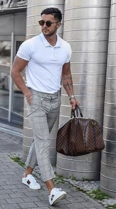 - with a summer outfit idea with a white polo shirt gray plaid trousers brown leather duffle bag white sneakers watch wrist wear sunglasses Polo Shirt Outfits, Polo Outfit, Outfits Hombre, Summer Fashion Outfits, Sneakers Fashion, Menswear, Men Casual, Mens Fashion, White Sneakers