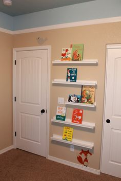 Bookshelves on wall to save space and cute paint idea. And I like the paint job but different colors