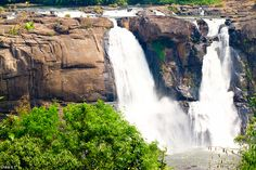 The beautiful Athirappally waterfalls in Kerala, India.    Love India, the monkeys, the curry, and of course waterfalls!