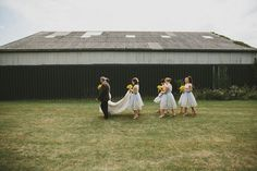 Outdoor Ceremony at Elmley Nature Reserve | Rustic Barn Reception | Chi Chi London Bridesmaid Dresses | Sunflower Bouquet | McKinley Rodgers Photography | http://www.rockmywedding.co.uk/bex-drew/