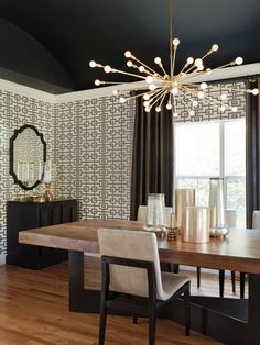 lizette marie designed dining room featuring sputnik light fixture hung from a black ceiling and cool mod trellis wallpaper.