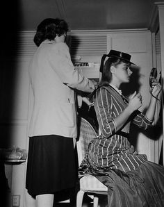 Hairdresser Mary Freeman gets Ingrid Bergman ready for a scene in Gaslight
