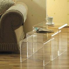 Lucite nesting tables as coffee table
