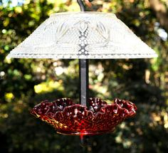 FREE U.S. SHIPPING This vintage glass squirrel proof bird feeder was created with ruby red Fenton glass and clear glass with hundreds of tiny hobnails and fleur de lis pattern around the globe. The hardware is powder finished in Wrinkle Black and also available in Textured White or Cafe Noir. Beautiful as bird feeder or glass garden art and just in time for Valentines Day giving.  The top shade is a Vintage Depression clear cut glass. The cut glass patterns, raised on the outside include…