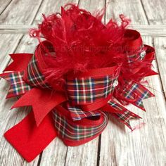 Invoke the spirit of the Christmas season year-round with this Scottish inspired red tartan over the top hair bow from Beautiful Bows Boutique. Christmas Hair Bows, Plaid Christmas, Handmade Christmas, Baby Bows, Baby Headbands, Girls Bows, Baby Girls, Big Hair Bows, Boutique Hair Bows