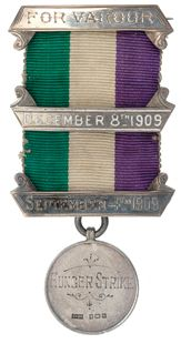 The term 'suffragette' was coined by the British press in 1906. It was used to distinguish the militant WSPU from other suffragist movements. Medals were issued to members imprisoned for their criminal acts - this one recognizing the fact that the member had been on hunger strike. The badge, a portcullis with a prisoner's arrow/crow's foot, commemorates imprisonment in Holloway Prison, north London. It was designed by Sylvia Pankhurst. Courtesy the Museum of London.