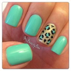Base Color: Gelish Mint of Spring from the Spring 2013 Love in Bloom collection (Mint Green). Accent Nail Colors: Gelish Meet the King (Gold frost) & Bronzed on top (Gold glitter). Konad special polish in Black to outline the leopard spots.