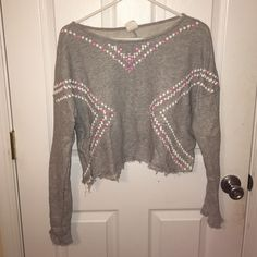 Gray cropped long sleeve Cropped grey long sleeve shirt with white and pink designs , barely worn , good condition Tokyo darling  Tops Tees - Long Sleeve