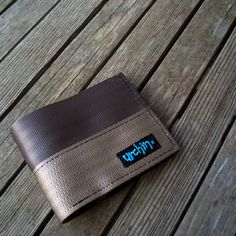 Eco friendly vegan seatbelt wallet made from reclaimed seat belt straps and used bike inner tube