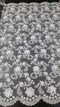 Beaded ivory lace fabric with 3D flowers. Both sides scalloped. Width: 140 cm/55.1 inches Item number: EVS005LB Price is set for one meter/yard. You will receive the fabric in one continuous piece if you purchase more than 1 meter/yard. You can purchase a sample here: