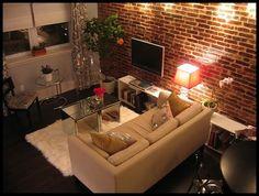 parede de tijolinhos a vista, sala de TV