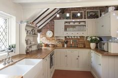 A kitchen with character. English Kitchens, Modern Farmhouse Kitchens, Home Kitchens, Farmhouse Style Kitchen, Country Kitchen, Brick Cottage, Tudor Cottage, Old Cottage, Brick Wall Kitchen