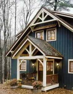 Cute country home.. love the dark blue against the beige and chocolate color trim.